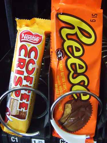 coffee crisp and reese cups in a vending machine